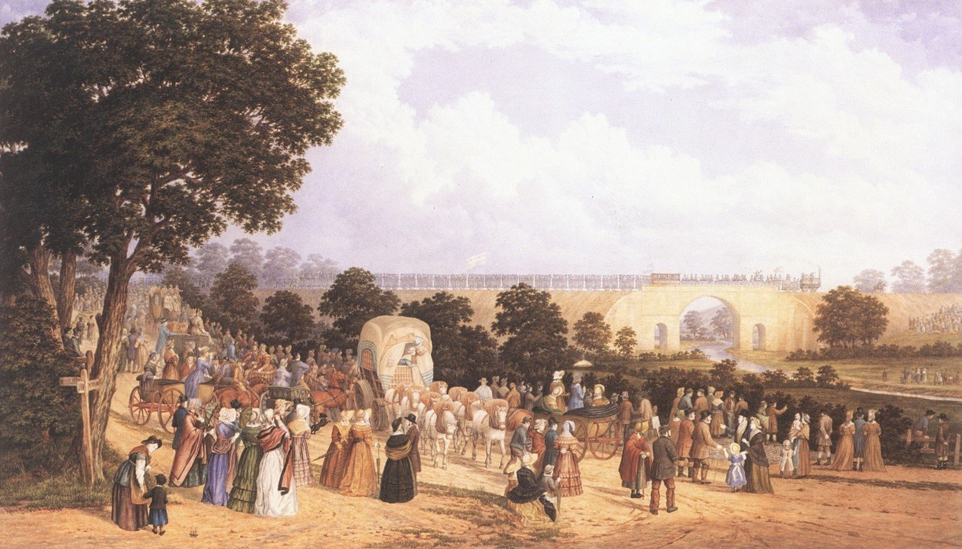 The opening day painted by John Dobbin in 1875. Dobbin attended the opening day in 1825 when he was ten years old. The train is passing over the Skerne Bridge in Darlington, hauled by Locomotion No.1. The passenger coach Experiment can be seen amongst the waggons. Photo: Darlington Borough Council